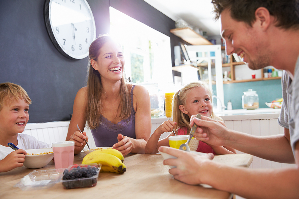 bigstock-Family-Eating-Breakfast-At-Kit-879920901
